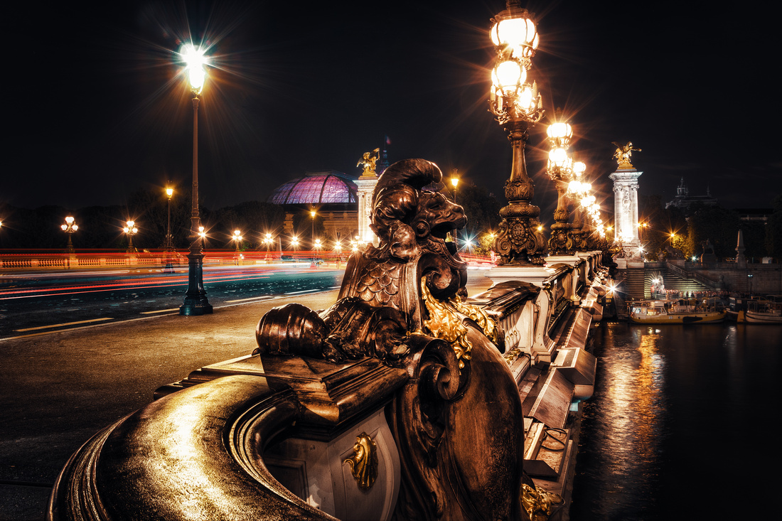 Le Pont Alexandre III past midnight in Paris.