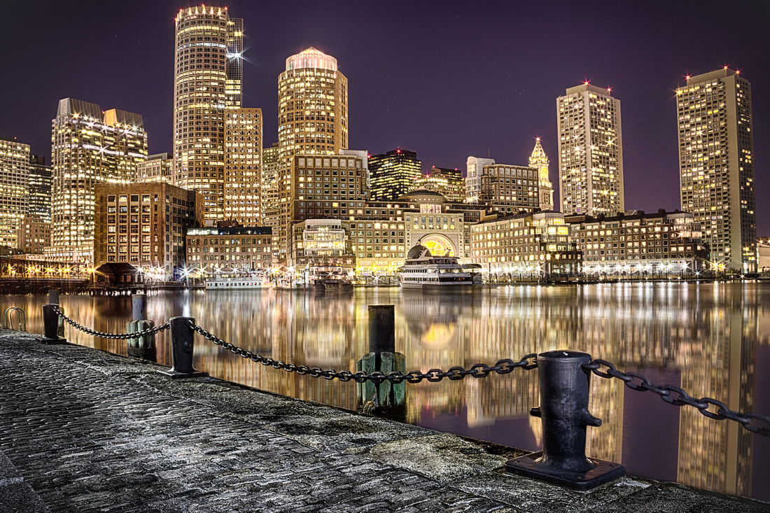 The Boston skyline lit up late at night.