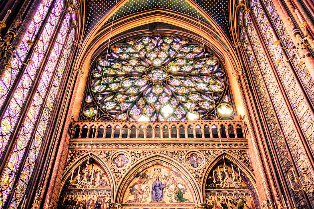 The rear stained glass window of La Sainte-Chapelle in Paris, France.