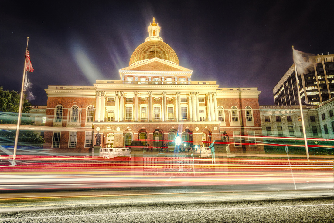 The Massachusetts State House at night.