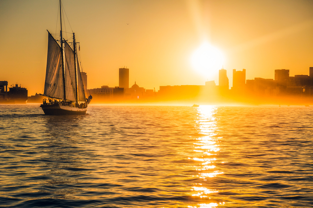Boston harbor shrouded in a golden sunset mist.