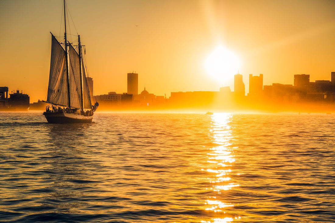 Boston harbor shrouded in a golden sunset mist.